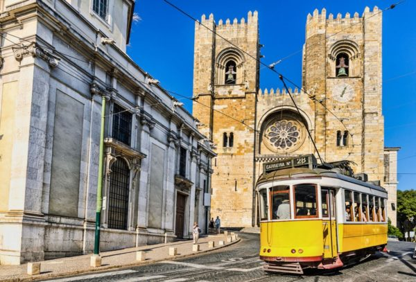 Typical tram and Cathedral Lisboa